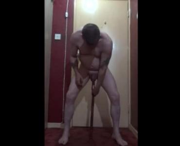 Tanned Brunette Is Kneeling On The Floor And Sucking A Huge Meat Stick Like A Slut