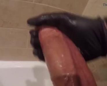 Dark Haired Lady With Long Hair Is Rubbing A Huge Cock In A Big Bed